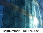 the glass facade of a... | Shutterstock . vector #1013263054