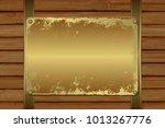 grunge plaque on wooden... | Shutterstock .eps vector #1013267776