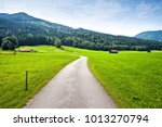 green alpine meadow and curved... | Shutterstock . vector #1013270794