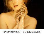 beautiful woman in gold  golden ... | Shutterstock . vector #1013273686