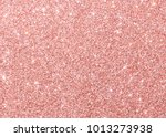 Stock photo rose gold pink red glitter background sparkling shiny wrapping paper texture for christmas holiday 1013273938