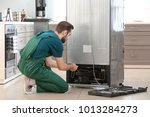male technician repairing... | Shutterstock . vector #1013284273