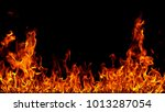 fire flames on black background. | Shutterstock . vector #1013287054