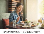 happy woman eating healthy... | Shutterstock . vector #1013307094