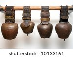 Four Antique Bells On Balk In...