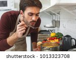 young man cooking romantic... | Shutterstock . vector #1013323708