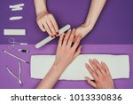 cropped image of nail... | Shutterstock . vector #1013330836