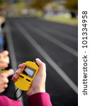 Stopwatch for running a race around a track with  lines - stock photo