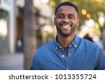 young man in city smile happy... | Shutterstock . vector #1013355724