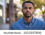 young man in city serious face... | Shutterstock . vector #1013357830