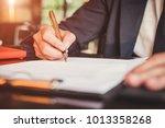 close up business man reaching... | Shutterstock . vector #1013358268