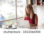 young blonde woman freelancer... | Shutterstock . vector #1013366500