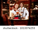 young two people in bavarian... | Shutterstock . vector #1013376253
