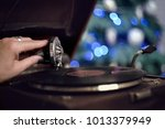 the hand of the person puts the ... | Shutterstock . vector #1013379949