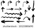 grunge vector arrows. dry brush ... | Shutterstock .eps vector #1013380690
