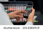 businessman using smartphone | Shutterstock . vector #1013383519