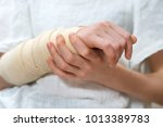 child arm with elastic bandage... | Shutterstock . vector #1013389783
