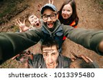 four crazy funny people selfie. ... | Shutterstock . vector #1013395480