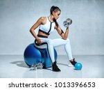strong woman working out with... | Shutterstock . vector #1013396653