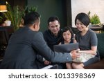 financial advisor with clients. | Shutterstock . vector #1013398369