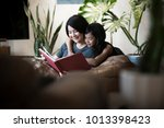 young asian mother and daughter ... | Shutterstock . vector #1013398423