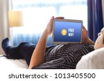 man using free hotel wifi with... | Shutterstock . vector #1013405500