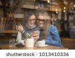 happy young women or teenage... | Shutterstock . vector #1013410336