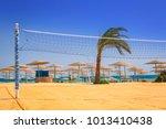 volleyball court on the beach... | Shutterstock . vector #1013410438