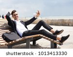 happy photogenic male manager... | Shutterstock . vector #1013413330