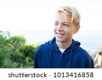 portrait of a happy teenager... | Shutterstock . vector #1013416858