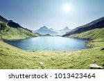 schreckhorn and wetterhorn from ... | Shutterstock . vector #1013423464