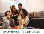group of young friends eating... | Shutterstock . vector #1013434108