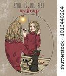 girl doing make up in front of... | Shutterstock . vector #1013440264