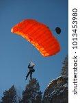 basejumper flies under the...   Shutterstock . vector #1013453980