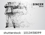 the singer sings into the... | Shutterstock .eps vector #1013458099