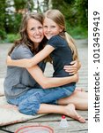mother and daughter hugging and ...   Shutterstock . vector #1013459419
