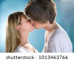young couple kiss | Shutterstock . vector #1013463766