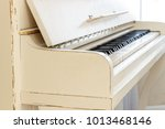 white piano  side view of...   Shutterstock . vector #1013468146