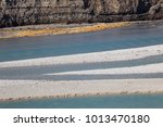 Small photo of Diagonal line of river coast with low level of water, Empty accumulation lake, Most na Soci, Slovenia, water background
