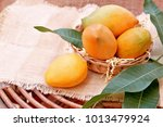 mango fruits in basket on... | Shutterstock . vector #1013479924