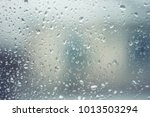 Rain Drops On Glass With Blue...