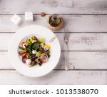 greek salad in a plate | Shutterstock . vector #1013538070