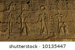 Egyptian basrelief and hieroglyphs in Karnak temple, Luxor, Egypt - stock photo