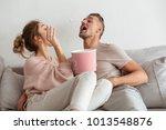 playful loving couple sitting... | Shutterstock . vector #1013548876