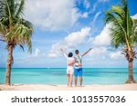 young couple on white beach... | Shutterstock . vector #1013557036