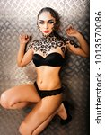 young sexy woman with leopard... | Shutterstock . vector #1013570086