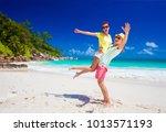 happy young couple having fun...   Shutterstock . vector #1013571193