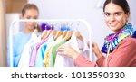 beautiful young stylist near...   Shutterstock . vector #1013590330
