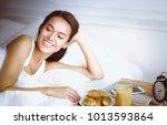young beautiful woman lying in... | Shutterstock . vector #1013593864