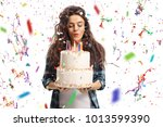 teenage girl blowing candles on ... | Shutterstock . vector #1013599390
